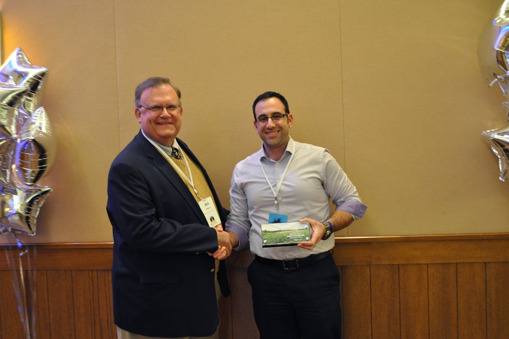 Lennar representative accepting the Innovation award from Manager Olson