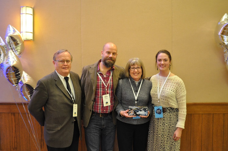 Group from Minneapolis Area Synod of ELCA accepting Service award from Manager Rogness