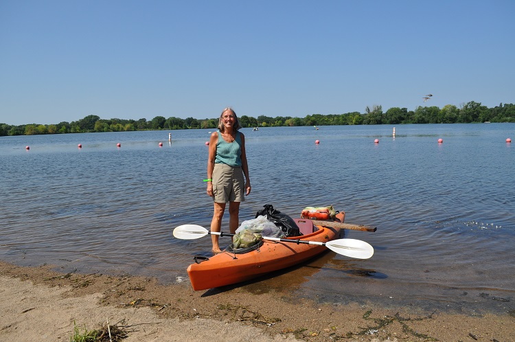Woman with trash she collected in her kayak at Lake Hiawatha Cleanup