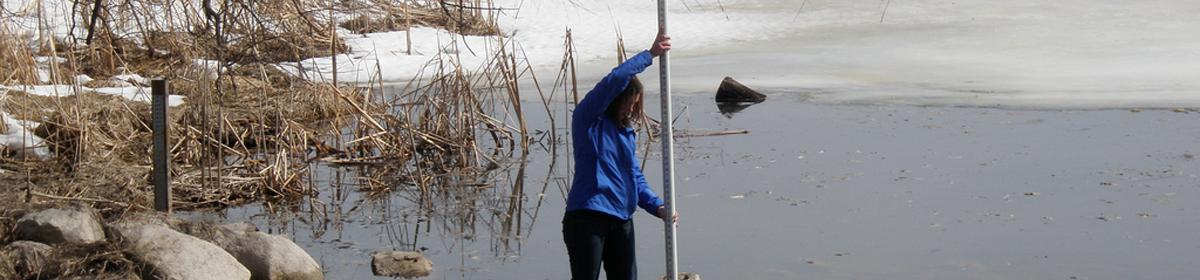 Measuring water levels at Gray's Bay in Lake Minnetonka.